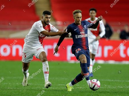 Monaco's Youssef Ait-Bennasser, left, battles for the ball with PSG's Neymar during the French League One soccer match between AS Monaco and Paris Saint-Germain at Stade Louis II in Monaco