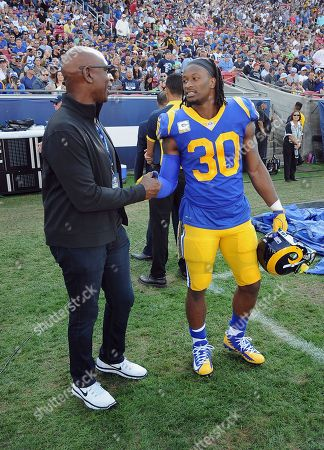 Eric Dickerson - Todd Gurley II. Los Angeles Rams running back Todd Gurley II (30) shakes hands with NFL Hall of Fame member and former Rams running back Eric Dickerson on the sidelines during a break in the action of an NFL football game against the Seattle Seahawks, in Los Angeles