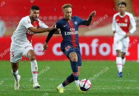 Youssef Ait-Bennasser (L) of AS Monaco and Neymar Jr (R) of Paris Saint Germain in action  during the French Ligue 1 soccer match between AS Monaco and Paris Saint Germain in Monaco, 11 November 2018.