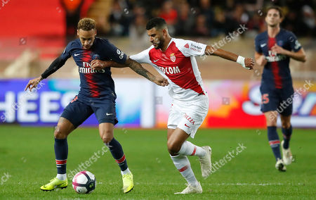 Youssef Ait Bennasser (R) of AS Monaco and Neymar Jr (L) of Paris Saint Germain in action during the French Ligue 1 soccer match between AS Monaco and Paris Saint Germain in Monaco, 11 November 2018.