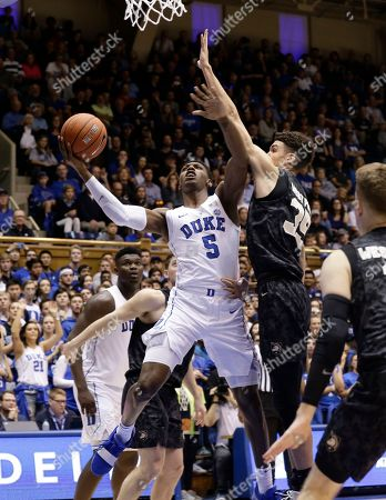 Stock Image of Duke's RJ Barrett (5) looks to shoot against Army's Alex King (35) during the second half of an NCAA college basketball game in Durham, N.C., . Duke won 94-72
