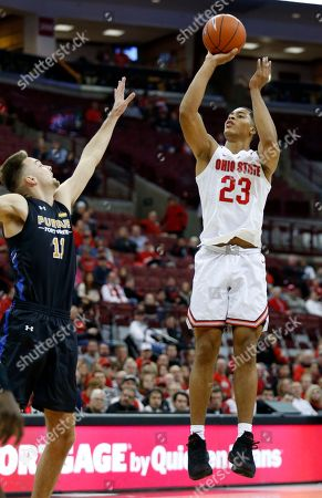 Ohio State forward Jaedon LeDee, right, goes up for a shot against Purdue Fort Wayne forward Dylan Carl during the second half of an NCAA college basketball game in Columbus, Ohio, . Ohio State won 107-61