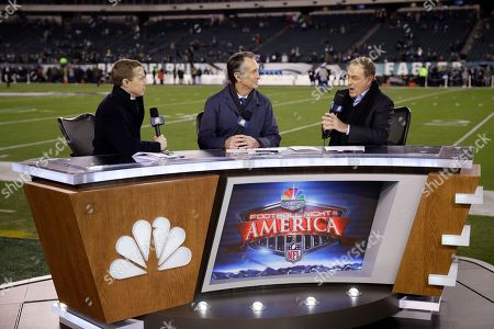 Liam McHugh, left, Cris Collinsworth, center, and Al Michaels speak during a television segment prior to an NFL football game between the Philadelphia Eagles and the Dallas Cowboys, in Philadelphia