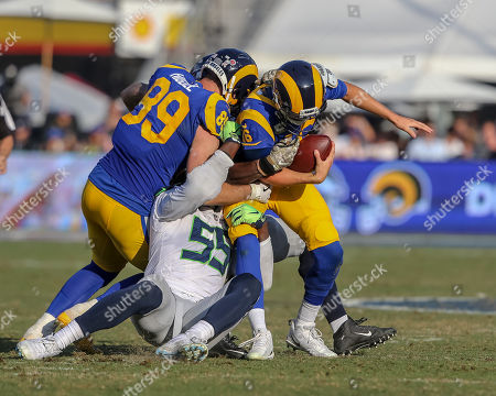 Los Angeles, CA...Seattle Seahawks defensive end Frank Clark (55) sacking Los Angeles Rams quarterback Jared Goff (16) during the NFL Seattle Seahawks vs Los Angeles Rams at the Los Angeles Memorial Coliseum in Los Angeles, Ca on , 2018. Jevone Moore