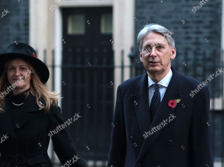 Philip Hammond, Chancellor of the Exchequer, and wife Susan Williams-Walker in Downing Street on the way to the Remembrance Sunday ceremony at the Cenotaph in Whitehall.