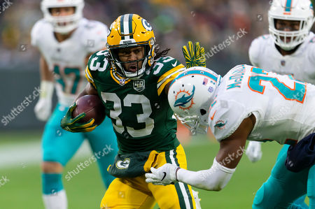 e5bf8220121 Green Bay Packers running back Aaron Jones  33 stiff arms Miami Dolphins  strong safety T.J.