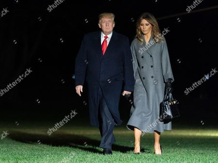 US President Donald J. Trump (L) and First Lady Melania Trump (R) arrive back at the White House after participating in events marking the 100th Anniversary of the World War I Armistice; in Washington, DC, USA, 11 November 2018.