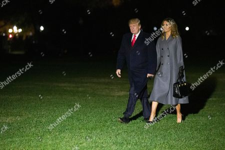 Donald Trump, Melania Trump. President Donald Trump walks with first lady Melania Trump, after stepping off Marine One, on the South Lawn of the White House, in Washington. Trump is returning from a trip to Paris