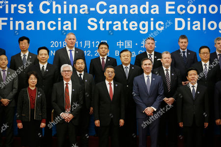 Chinese State Councillor Wang Yong (C, first row), Canadian Finance Minister Bill Morneau (C-R, first row), Canadian International Trade Diversification Minister Jim Carr (C-L first row) and delegates attend a group photo event ahead of the first China-Canada economic and financial strategy dialogue in Beijing, China, 12 November 2018.
