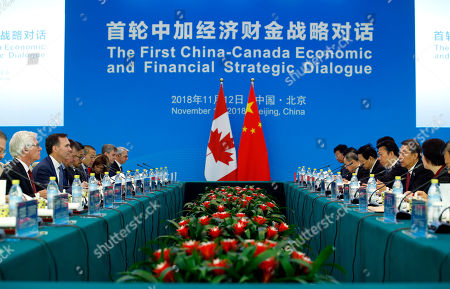 Chinese State Councillor Wang Yong (2-R), Canadian Finance Minister Bill Morneau (2-L), and International Trade Diversification Minister Jim Carr (L) attend the first China-Canada economic and financial strategy dialogue in Beijing, China, 12 November 2018.