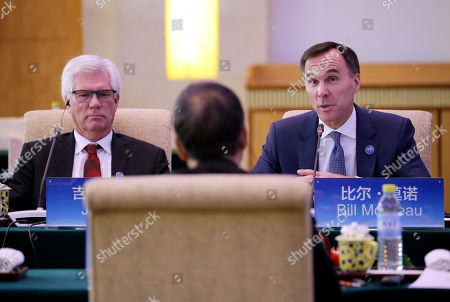 Canadian Finance Minister Bill Morneau (R) speaks next to International Trade Diversification Minister Jim Carr (L) at the first China-Canada economic and financial strategy dialogue in Beijing, China, 12 November 2018.