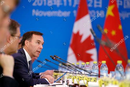 Canadian Finance Minister Bill Morneau speaks at the first China-Canada economic and financial strategy dialogue in Beijing, China, 12 November 2018.