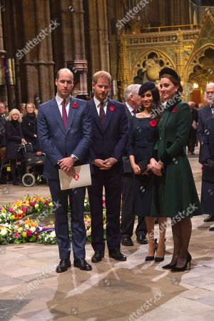 Prince Harry and Meghan Duchess of Sussex   and Prince William and Catherine Duchess of Cambridge process pass the Grave of the Unknown Warrior at the end fo the service.