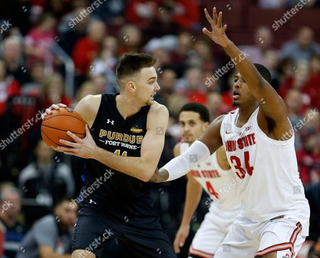 Purdue Fort Wayne forward Dylan Carl, left, works against Ohio State forward Kaleb Wesson during an NCAA college basketball game in Columbus, Ohio, . Ohio State won 107-61