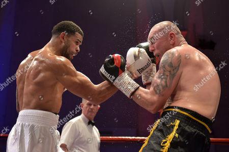 Julian Wilson (white shorts) defeats Jan Hrazdira during a Boxing Show at the Corn Exchange on 10th November 2018
