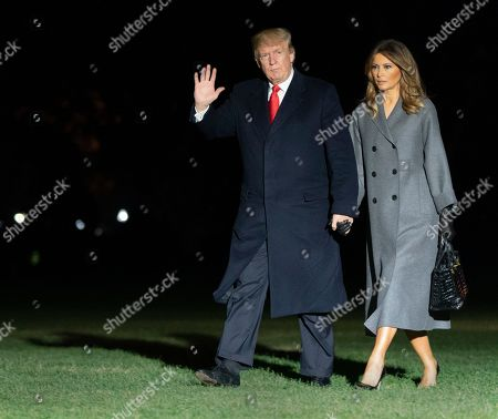 Stock Image of United States President Donald J. Trump and first lady Melania Trump arrive back at the White House in Washington, DC after participating in events marking the 100th Anniversary of the World War I Armistice.