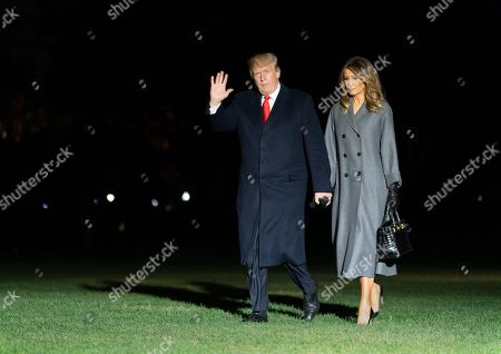 Stock Picture of United States President Donald J. Trump and first lady Melania Trump arrive back at the White House in Washington, DC after participating in events marking the 100th Anniversary of the World War I Armistice.