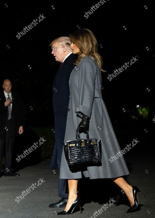 United States President Donald J. Trump and first lady Melania Trump arrive back at the White House in Washington, DC after participating in events marking the 100th Anniversary of the World War I Armistice.