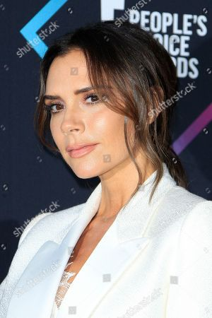 Victoria Beckham poses in the press room of the 2018 People's Choice Awards at Barker Hangar in Santa Monica, California, USA, 11 November 2018.