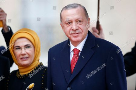 Turkish President Recep Tayyip Erdogan with his wife Emine Gulbaran (background) at the Elysee palace for the official lunch after the international ceremony for the Centenary of the WWI Armistice of 11 November 1918, in Paris