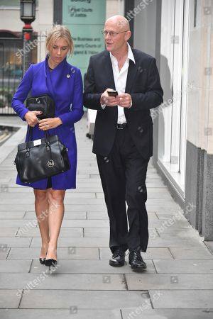John Caudwell  Phones4u Founder John Caudwell Leaves The High Court Rolls Building In London With His Girlfriend After The Second Day Of His Legal Battle Against Former Employee Nathalie Dauriac-stoebe  181017