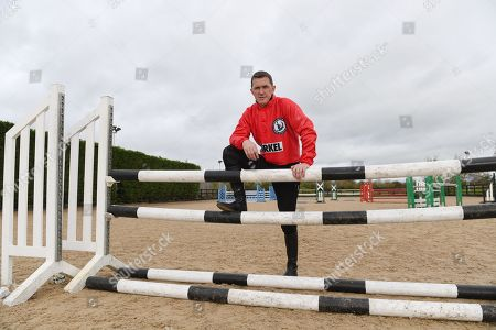 Stock Photo of Jockey Ap McCoy And Legends Richard Dunwoody Peter Scudamore And John Francome Prepare For Olympia And Demonstrate Their Showjumping Abilities.