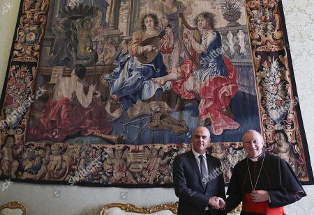 Swiss Federal President Alain Berset (L) meets Vatican's Secretary of State Cardinal Pietro Parolin after a private audience with Pope Francis at the Vatican, 12 November 2018.