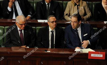 Tunisian Prime Minister Youssef Chahed (R) along with Tunisian Minister of the Civil Service, Modernization of Administration and Public Policy Kamel Morjane (L) as Minister of Justice Karim Jamoussi (C) attend a session of the House of People's Representatives (HPR) dedicated to the vote of confidence on the new government members, in Tunis, Tunisia, 12 November 2018. Tunisian lawmakers held a session to decide on the new government members proposed by Prime Minister Youssef Chahed on 05 November in a cabinet reshuffle.