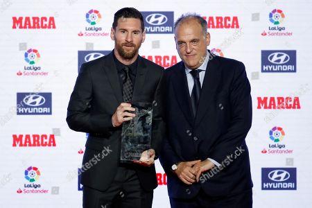 FC Barcelona's Argentinian forward Leo Messi (L) receives the Alfredo Di Stefano Award for the best player of 2017/2018 LaLiga's season from Javier Tebas, president of Liga de Futbol Profesional (LFP), during the awarding ceremony of MARCA sport newspaper held in Barcelona, Catalonia, Spain, 12 November 2018.