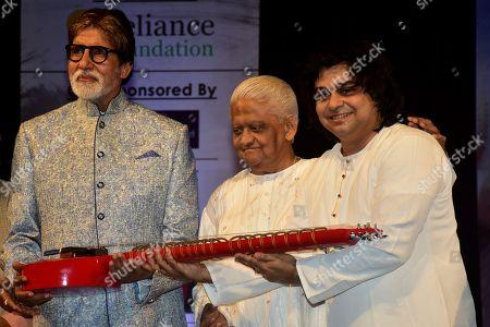 Indian film actor Amitabh Bachchan, Pyarelal Sharma and musician Niladri Kumar