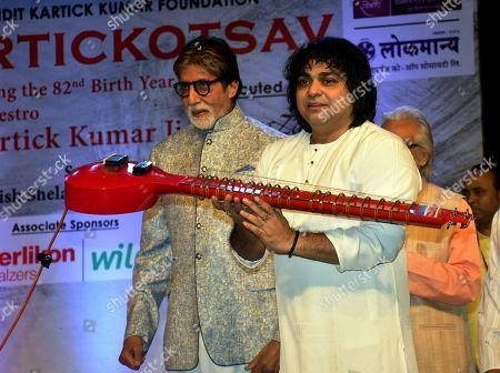 Indian film actor Amitabh Bachchan with musician Niladri Kumar