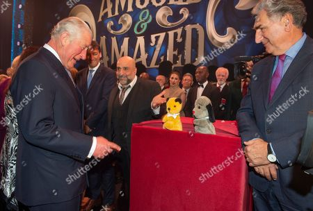 Prince Charles meets members of the Cast after the Show. Pictured meeting puppets Sooty and Sweep, encouraged by Omid Djalili.