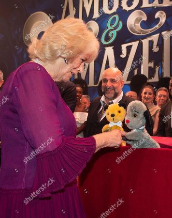 Camilla Duchess of Cornwall  meeting puppets Sooty and Sweep, encouraged by Omid Djalili.