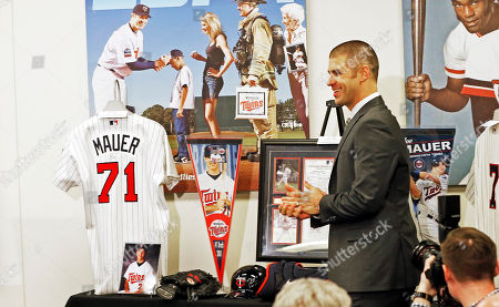 Joe Mauer arrives for his retirement news conference, in Minneapolis, after playing 15 major league seasons, all with the Minnesota Twins baseball team