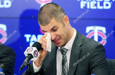 Joe Mauer wipes away tears during his retirement news conference, in Minneapolis, after playing 15 major league seasons, all with the Minnesota Twins baseball team