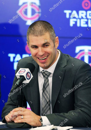 Minnesota Twins' Joe Mauer enjoys a laugh during his baseball retirement news conference, in Minneapolis, after playing 15 major league seasons, all with the Twins