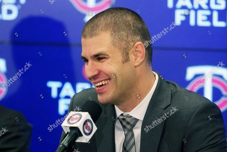 Minnesota Twins' Joe Mauer takes a question during his baseball retirement news conference, in Minneapolis, after playing 15 major league seasons, all with the Twins