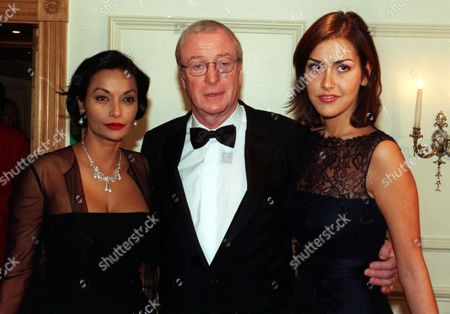 The Evening Standard British Film Awards 1998 At The Savoyactor Michael Caine Before Receiving His 'special Award' With His Daughter Natasha And Wife Shakira Baksh.