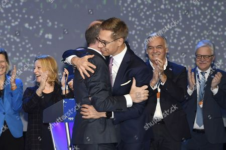 The lead candidates of the EPP, Manfred Weber of Germany and Alexander Stubb of Finland (R) hug after the results of the EPP lead candidate voting at the session of the European People's Party (EPP) congress