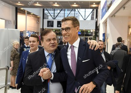 A candidate to lead EPP, Alexander Stubb of Finland gets a hug from an unidenfied supporter (L) at the European People's Party (EPP) congress