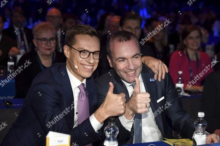 The lead candidates of the EPP, Alexander Stubb of Finland (L) and Manfred Weber of Germany pose together before the session of the European People's Party (EPP) congress