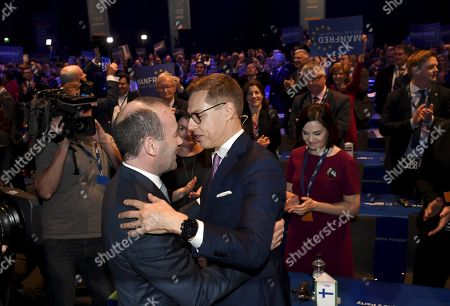 The candidates to lead EPP, Manfred Weber of Germany (L) and Alexander Stubb of Finland greet each other after their speeches at the European People's Party (EPP) congress