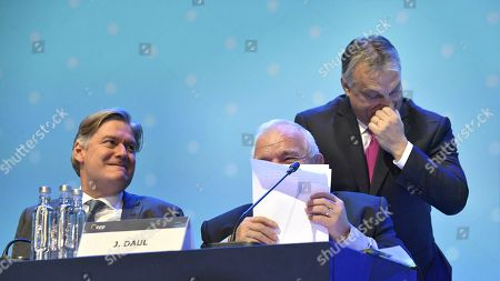 EPP Secretary General Antonio Lopez-Isturiz White (L) and EPP President Joseph Daul share a light moment with Hungarian President Viktor Orban (R) at the European People's Party (EPP) congress