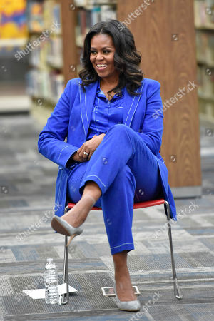 "Former first lady Michelle Obama speaks with students about her upcoming book ""Becoming"" during a roundtable discussion at Whitney M. Young Magnet High School,, in Chicago"