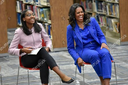 "Student Rebecca sits next to former first lady Michelle Obama as she speaks with students about her upcoming book ""Becoming"" during a roundtable discussion at Whitney M. Young Magnet High School,, in Chicago"