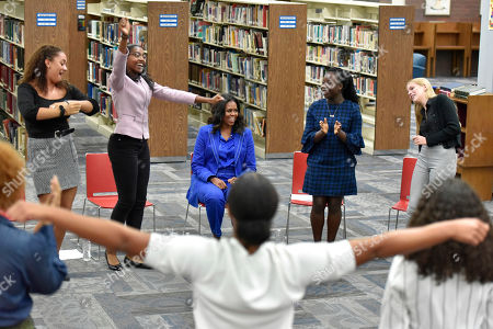 "Former first lady Michelle Obama is greeted by students doing a school cheer during a roundtable discussion about her upcoming book ""Becoming"" at Whitney M. Young Magnet High School,, in Chicago"