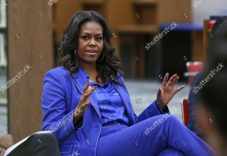 "Former first lady Michelle Obama speaks with students at her alma mater, Whitney M. Young Magnet High School, on Chicago's West Side, a day before the launch of a book tour to promote her memoir, ""Becoming"