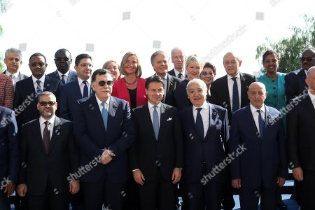 Italian Prime Minister Giuseppe Conte (C, front) poses for a family photo with the participants of the two-day 'Conference on Libya' in Palermo, Sicily island, southern Italy, 13 November 2018. In picture are seen (L-R, front row) chairman of Libya's High Council of State Khaled al-Mishri, Prime Minister of Libya Fayez al-Sarraj, Italian Prime Minister Giuseppe Conte, Head of the United Nations Support Mission in Libya Ghassan Salame and President of the Libyan House of Representatives Aguila Saleh Issa.