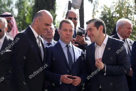 (L-R) President of Switzerland Alain Berset, Russian Prime Minister Dimitry Medvedev and Greek Prime Minister Alexis Tsipras attend the two-day 'Conference on Libya' in Palermo, Sicily island, southern Italy, 13 November 2018.