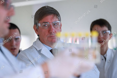 Belgian Finance Minister Johan Van Overtveldt (C) looks at a laboratory assistant displaying the beer analysis process during the inauguration of the new building of the Customs and Excise Laboratory of the FPS Finance in Vilvoorde, Belgium, 13 November 2018. All beers marketed in Belgium are first analysed in the new laboratory to measure the original extract of beer and thus be able to determine excise duties. Fuel samples are also analysed to verify that no fraud is committed.